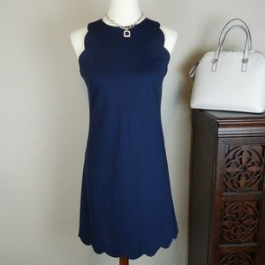 Vince Camuto navy dress with scalloped detailing